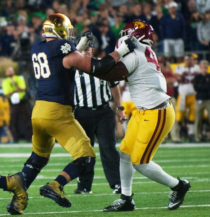 Graduate student left tacke Mike McGlinchey battles to protect the quarterback during Notre Dame's 49-14 win over USC on Sat.
